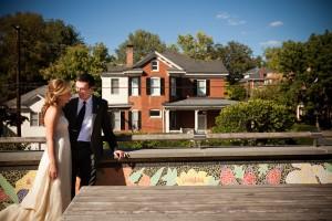 Bride and Groom near the brick house